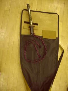 Interior view, showing pouch for katana sized weapons with velcro strap